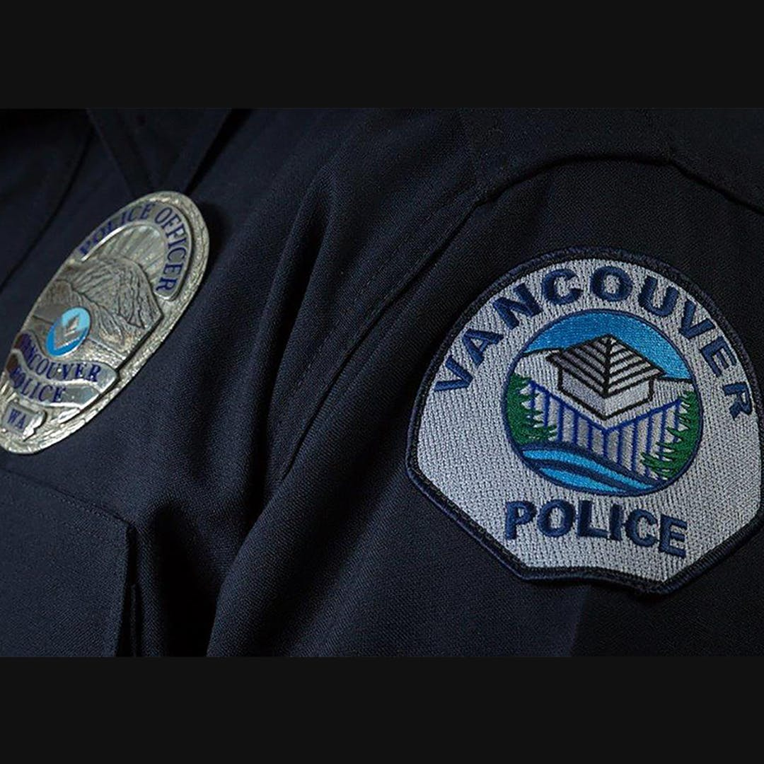 Vancouver Police Department Dark Blue Uniform Shirt with badge and shoulder patch displayed.