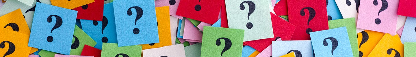 Colorful pieces of paper with questions marks on them