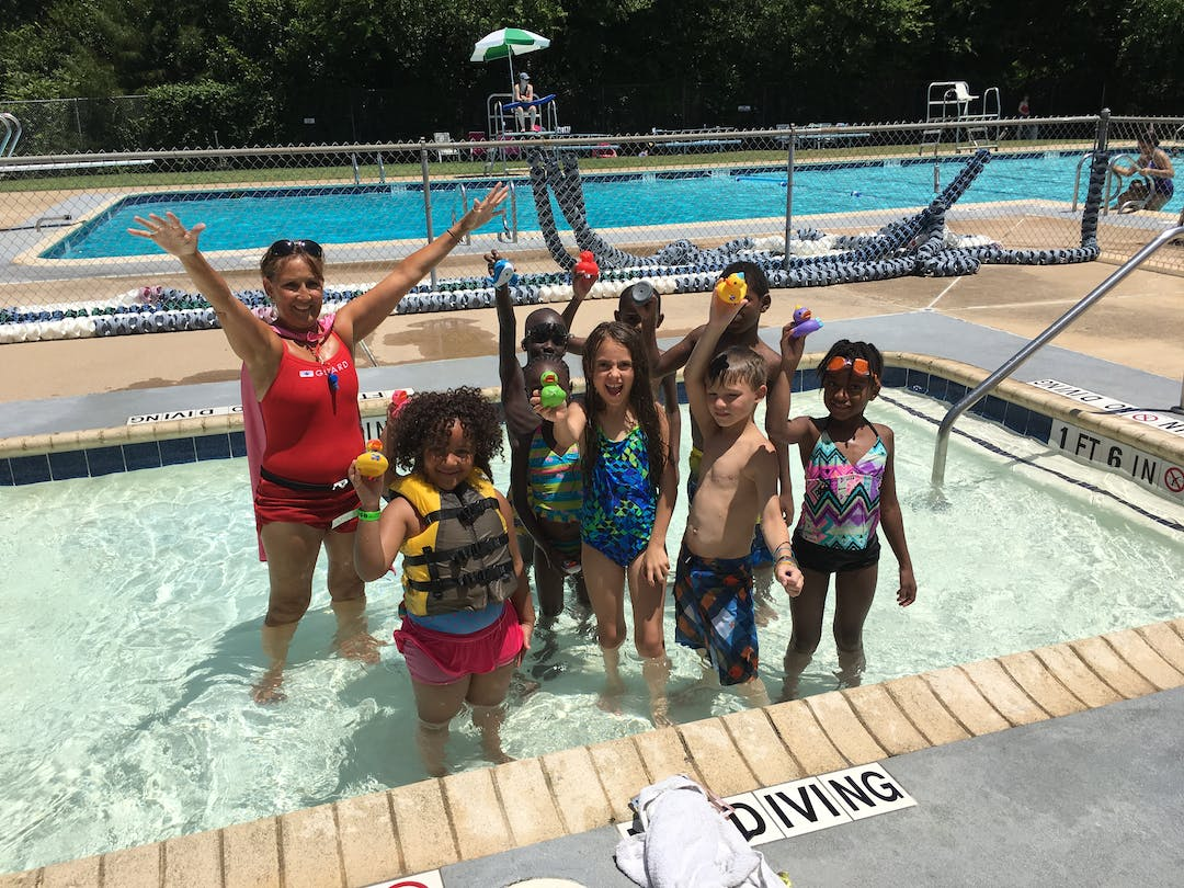 Kids and adults swimming in Crawford Park Pool.