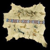 White Swan's Buffalo robe. Created by White Swan and other unidentified artists. Crow painted pictographic buffalo hide with beaded blanket strip joining the two sides.
