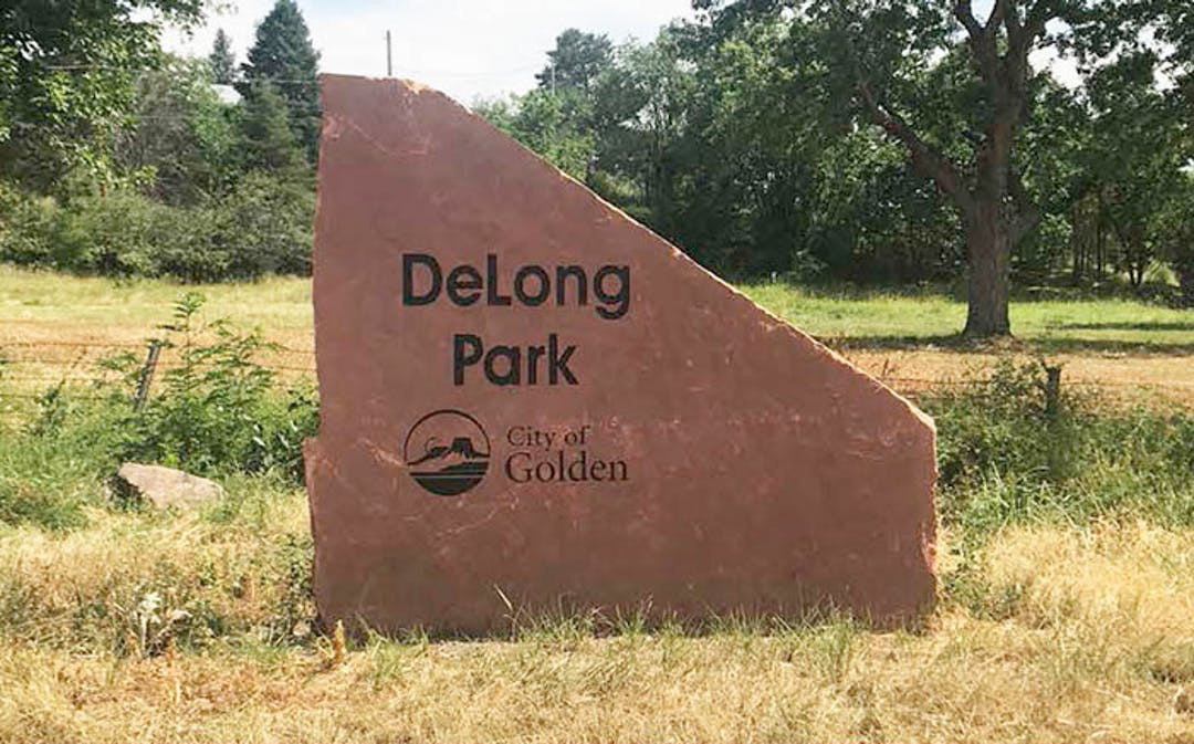 DeLong Park sign on red rock