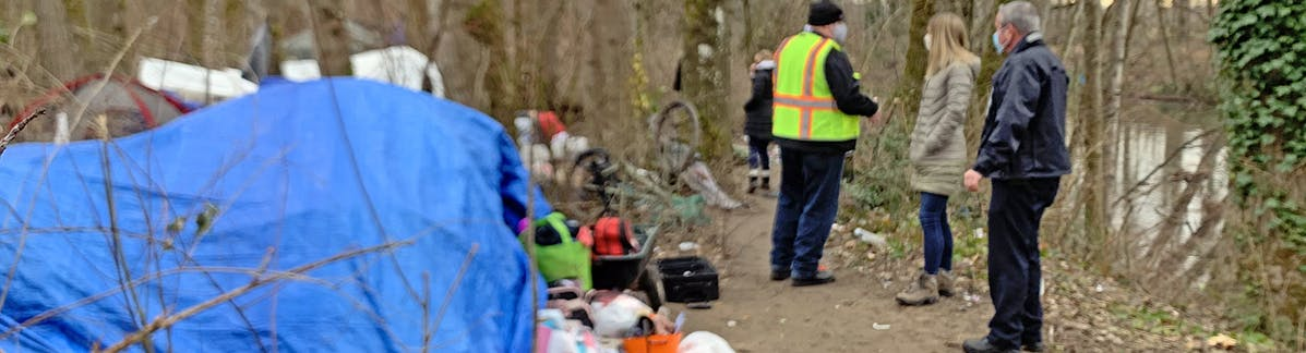 City staff respond to homeless encampments along the Puyallup River in Sumner.