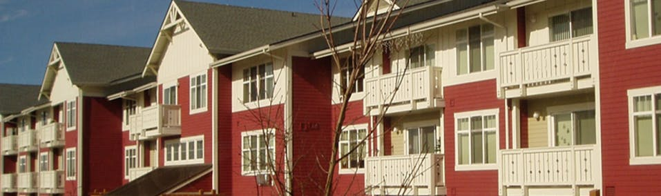 A row of red and white apartments and townhomes