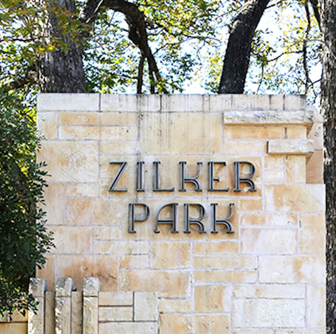 Sign welcoming people to Zilker Park as they drive west on Barton Springs Road.