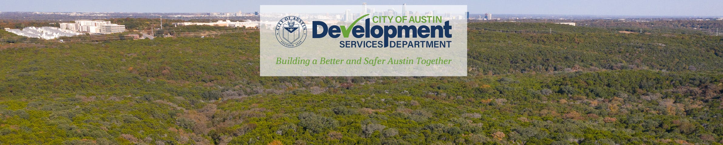 City of Austin skyline with trees in foreground and DSD logo