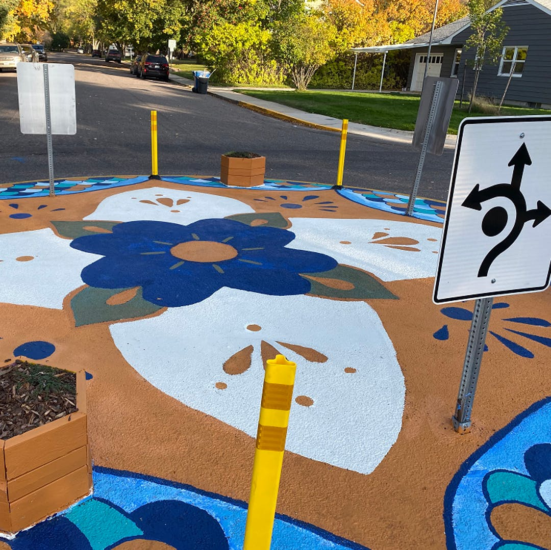 Neighbors painted a flower mandala design in the center of the quick-build traffic circle at the intersection of Maurice Ave. and Hastings St.