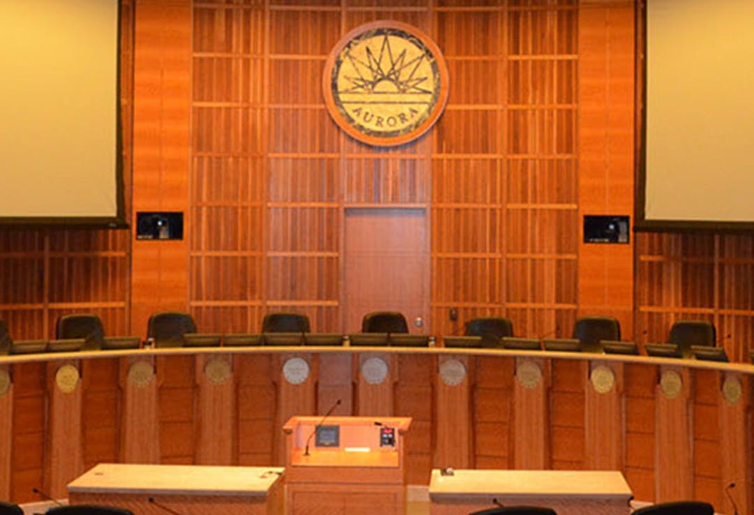 An image of the council dais at the Aurora Municipal Center
