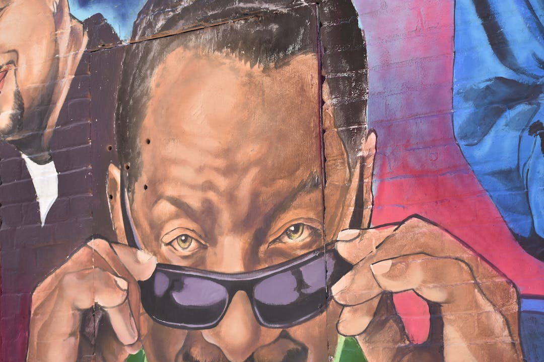 Mural of Donnie Simpson taking off his sunglasses