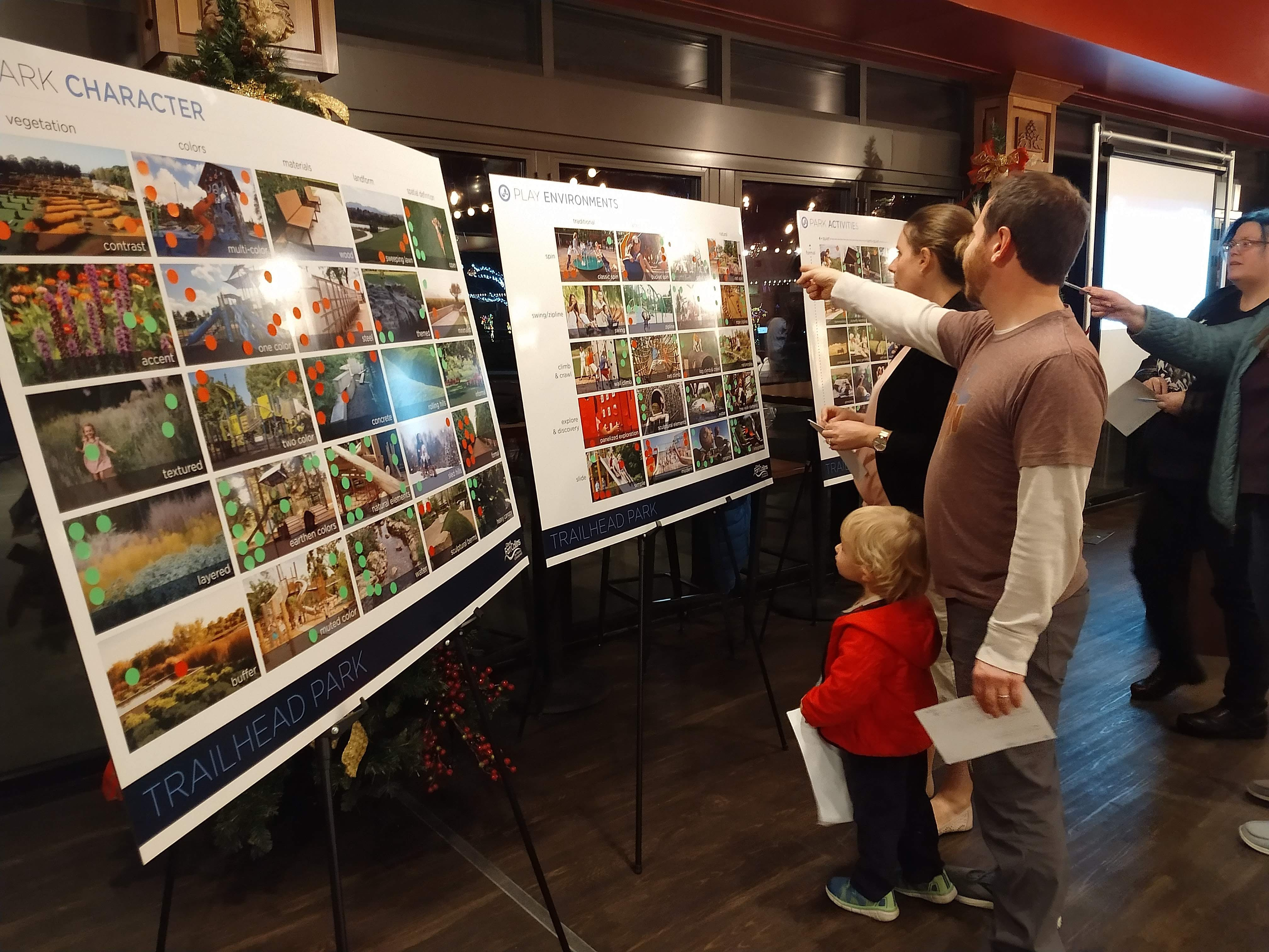 Attendees review plans on Trail Head Neighborhood Meeting