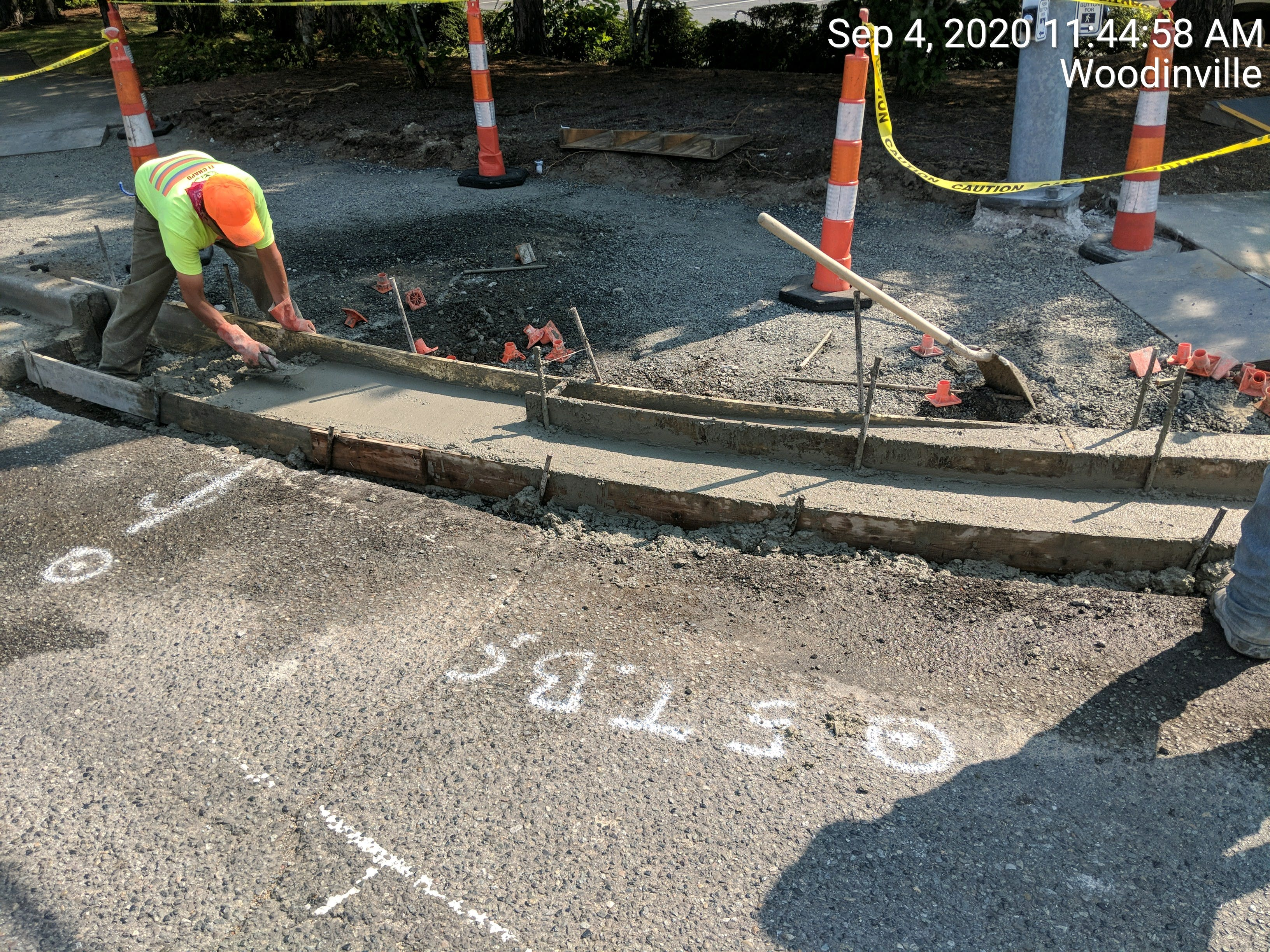 Wood-Sno Paving: Finishing curb and gutter on 178th.jpg