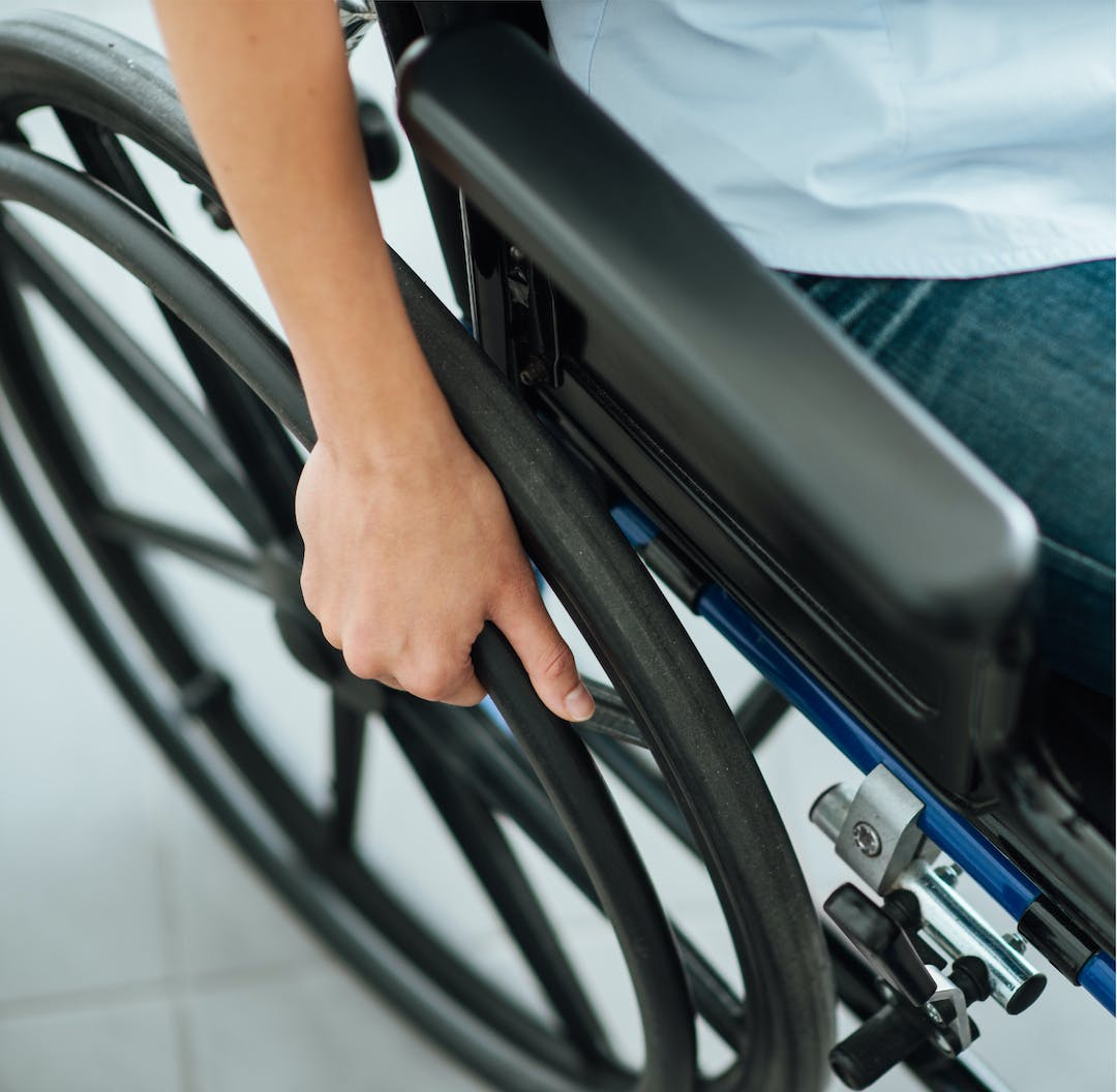 Image of a person in a wheelchair