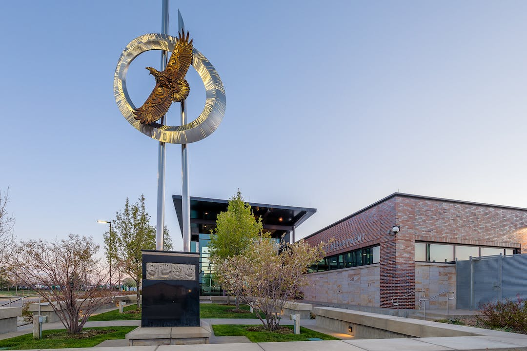 The Parker Police Department and the statue of a flying bird.