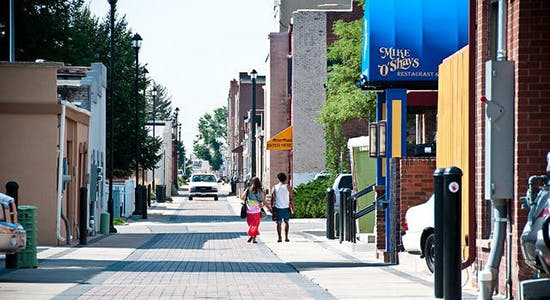 People walk down a downtown Alleyscape August 9, 2013