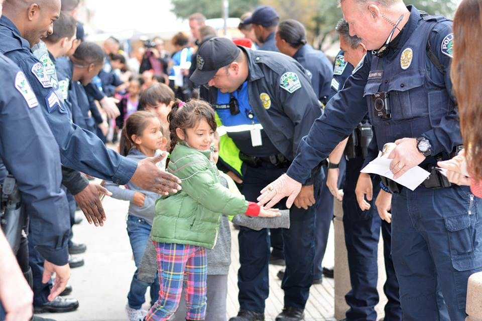 Photo of officers and children