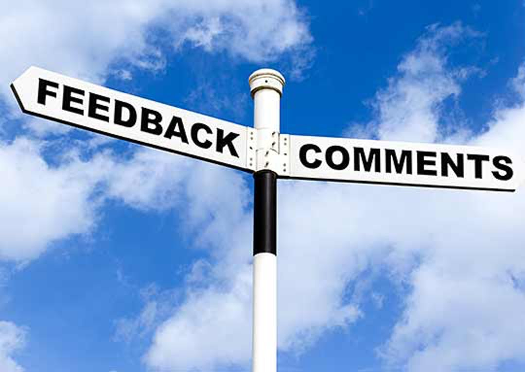 A sign that points to feedback one direction and comments in the other with a blue sky background.